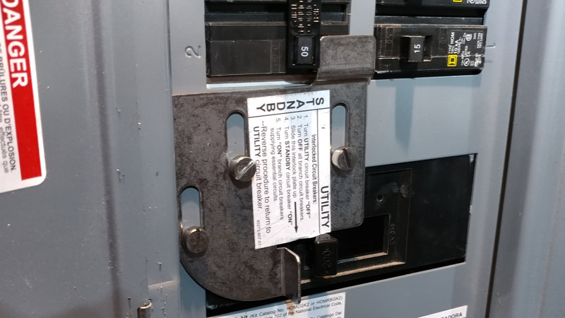 Generator safety interlock installed in a circuit breaker panel