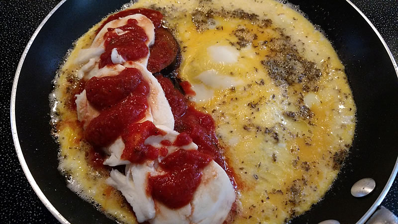 Eggplant Parmigiana omelette in frying plan